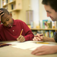 Little Brother Omar completes homework