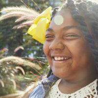 Little Sister Smiling in Sunshine